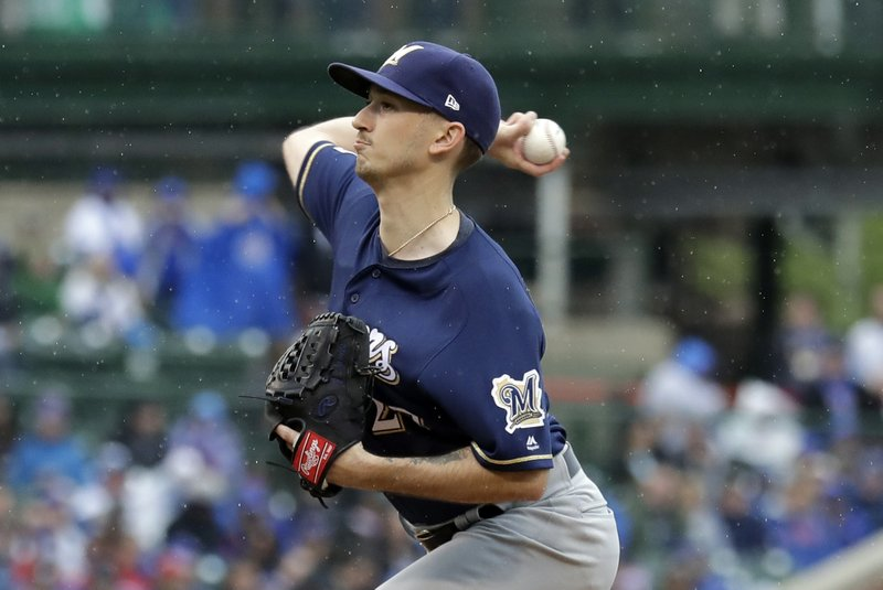 Milwaukee Brewers starting pitcher Zach Davies throws against the Chicago Cubs during the first inning of a baseball game Saturday, May 11, 2019, in Chicago. (AP Photo/Nam Y. Huh)