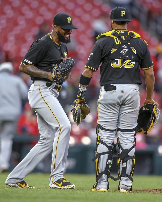 Pittsburgh Pirates relief pitcher Felipe Vazquez, left, celebrates with catcher Elias Diaz (32) after the final out of the team's baseball game against the St. (AP Photo/Scott Kane)