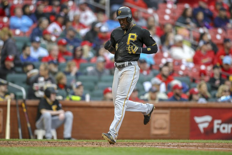 Pittsburgh Pirates' Starling Marte scores a run during the fourth inning of a baseball game against the St. (AP Photo/Scott Kane)
