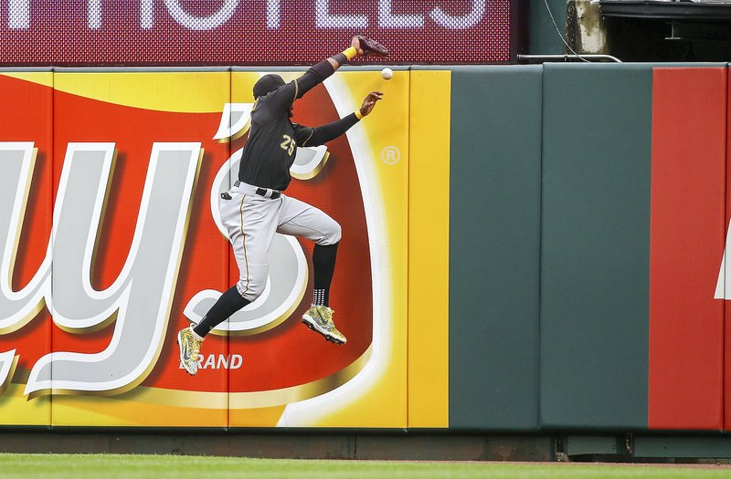 Pittsburgh Pirates right fielder Gregory Polanco (25) is unable to make a catch on a ball hit by St. Louis Cardinals' Paul DeJong for an RBI double during the third inning of a baseball game Saturday, May 11, 2019, in St. (AP Photo/Scott Kane)