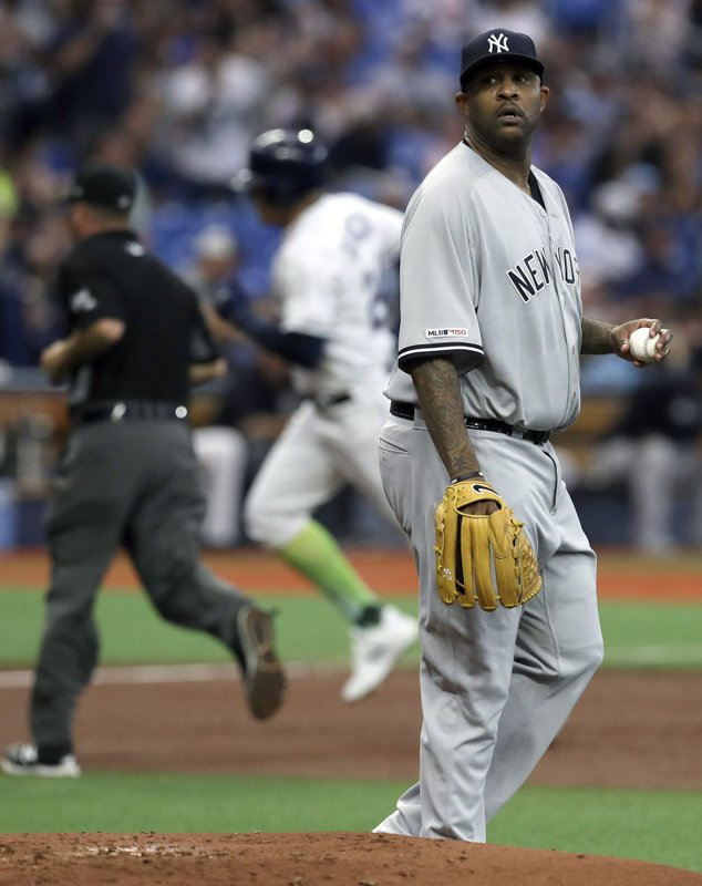 New York Yankees starting pitcher CC Sabathia, right, walks behind the mound as Tampa Bay Rays' Avisail Garcia runs the bases after hitting a home run during the second inning of a baseball game Saturday, May 11, 2019, in St. (AP Photo/Chris O'Meara)