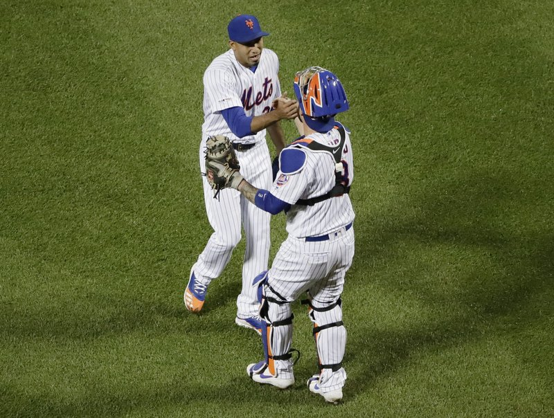 New York Mets relief pitcher Edwin Diaz, left, celebrates with catcher Tomas Nido after the team's baseball game against the Miami Marlins on Saturday, May 11, 2019, in New York. (AP Photo/Frank Franklin II)