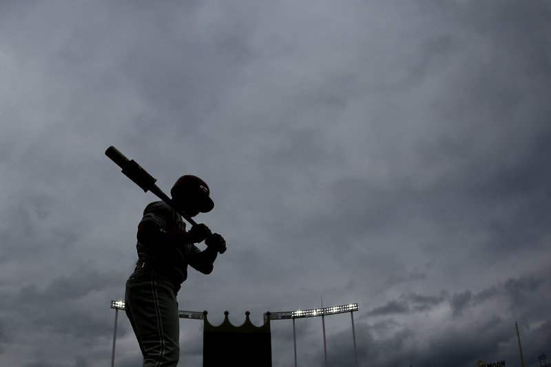 Philadelphia Phillies' Andrew McCutchen warms up on-deck during the first inning of a baseball game against the Kansas City Royals, Saturday, May 11, 2019, in Kansas City, Mo. (AP Photo/Charlie Riedel)