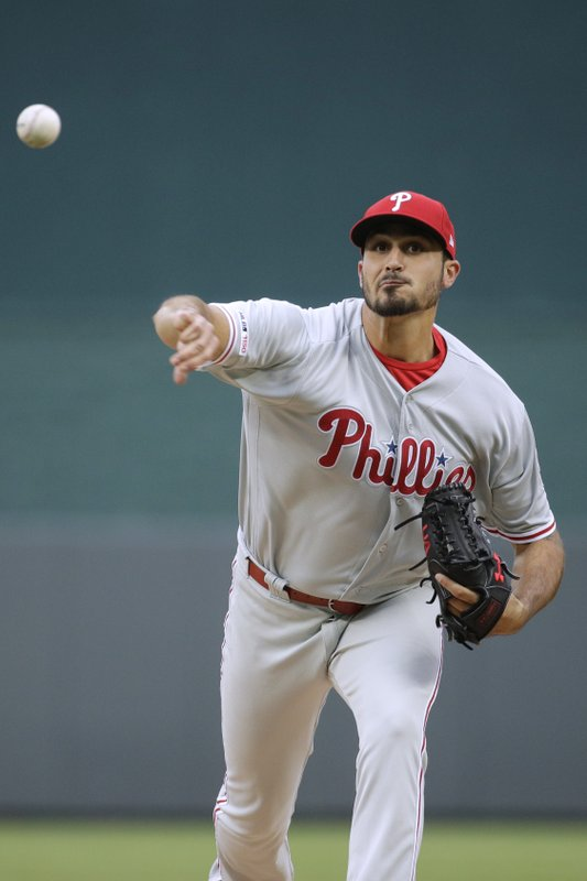 Philadelphia Phillies starting pitcher Zach Eflin throws during the first inning of a baseball game against the Kansas City Royals, Saturday, May 11, 2019, in Kansas City, Mo. (AP Photo/Charlie Riedel)