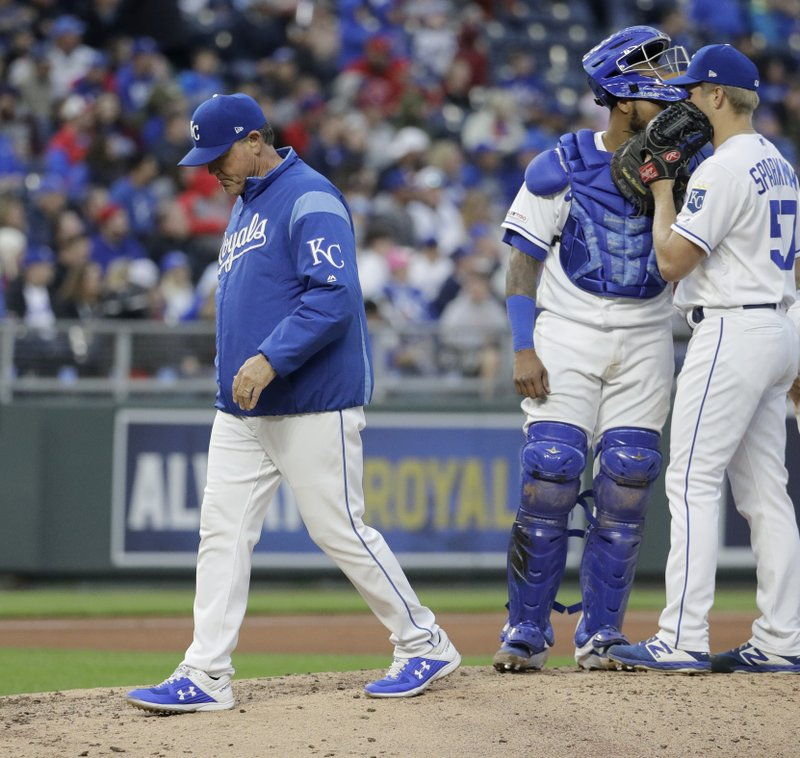 Kansas City Royals manager Ned Yost walks back to the dugout after making a pitching change during the sixth inning of a baseball game against the Philadelphia Phillies, Saturday, May 11, 2019, in Kansas City, Mo. (AP Photo/Charlie Riedel)