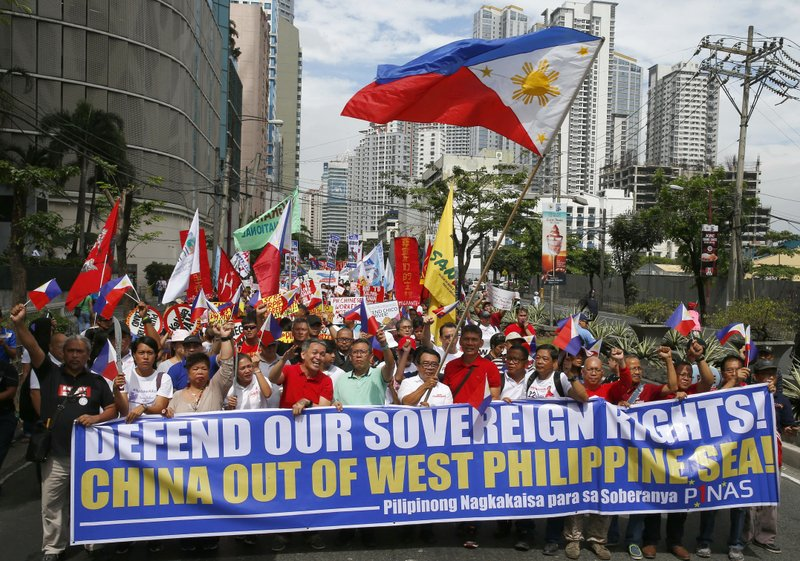 In this April 9, 2019, photo, hundreds of protesters march for a rally towards the Chinese Consulate to coincide with the country's commemoration of