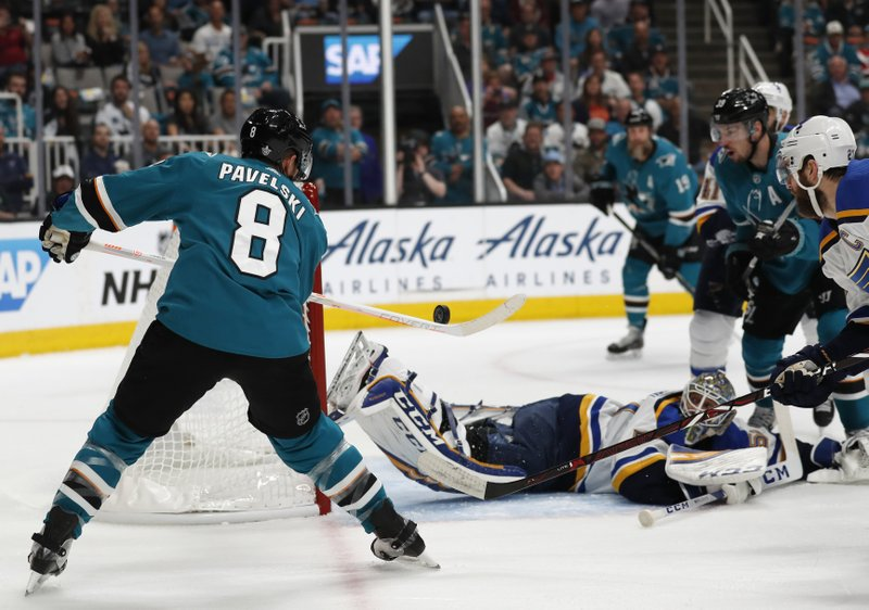 San Jose Sharks' Joe Pavelski (8) scores a goal against St. Louis Blues goaltender Jordan Binnington (50) in the first period in Game 1 of the NHL hockey Stanley Cup Western Conference finals in San Jose, Calif. (AP Photo/Josie Lepe)