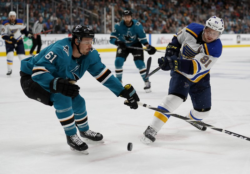 San Jose Sharks' Justin Braun (61) battles for the puck against St. Louis Blues' Vladimir Tarasenko (91) in the second period in Game 1 of the NHL hockey Stanley Cup Western Conference finals in San Jose, Calif. (AP Photo/Josie Lepe)