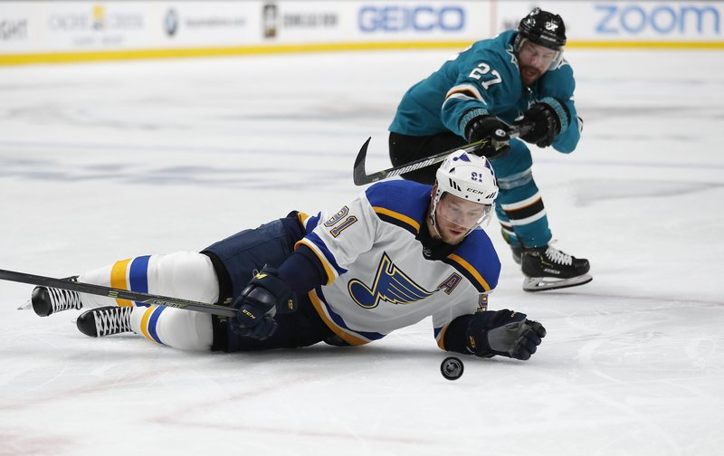 St. Louis Blues' Vladimir Tarasenko (91) battles for the puck against San Jose Sharks' Joonas Donskoi (27) in the second period in Game 1 of the NHL hockey Stanley Cup Western Conference finals in San Jose, Calif. (AP Photo/Josie Lepe)