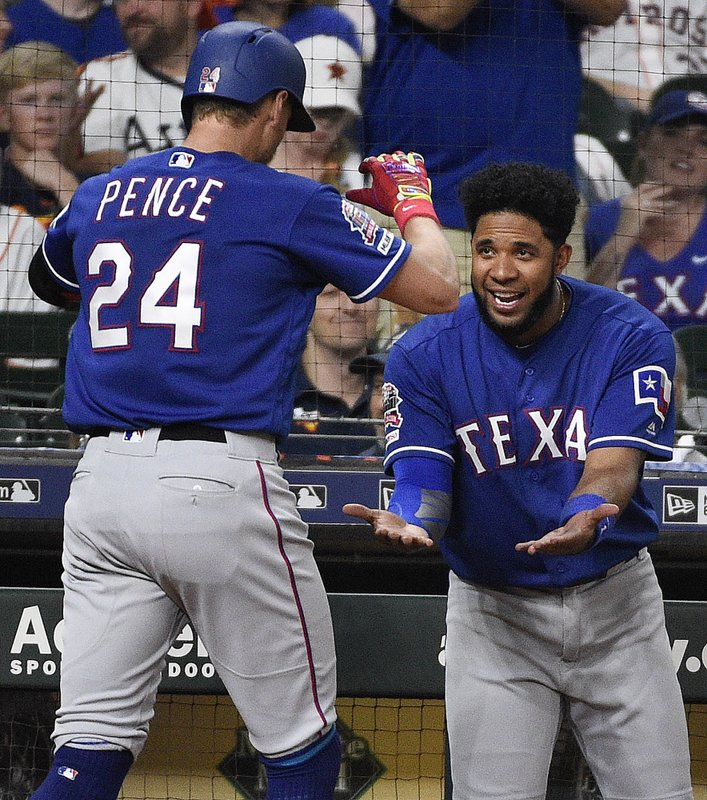 Texas Rangers' Hunter Pence (24) celebrates his solo home run off Houston Astros starting pitcher Gerrit Cole with Elvis Andrus during the second inning of a baseball game Saturday, May 11, 2019, in Houston. (AP Photo/Eric Christian Smith)