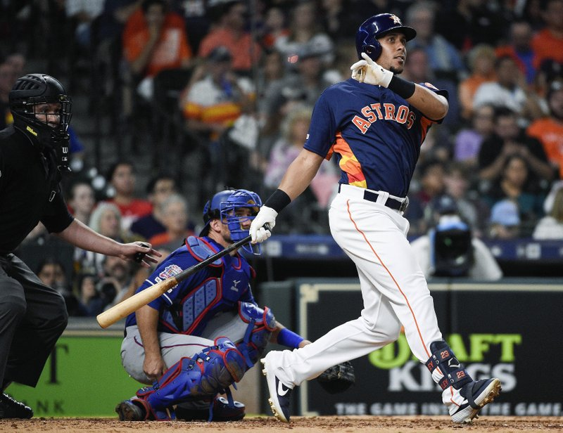 Houston Astros' Michael Brantley watches his solo home run off Texas Rangers relief pitcher Drew Smyly during the fourth inning of a baseball game Saturday, May 11, 2019, in Houston. (AP Photo/Eric Christian Smith)