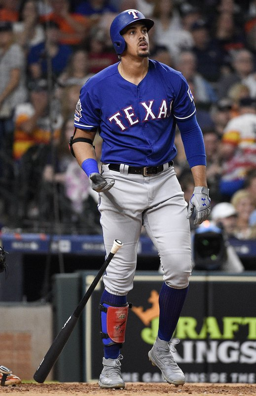 Texas Rangers' Ronald Guzman watches his three-run home run off Houston Astros relief pitcher Chris Devenski during the seventh inning of a baseball game Saturday, May 11, 2019, in Houston. (AP Photo/Eric Christian Smith)
