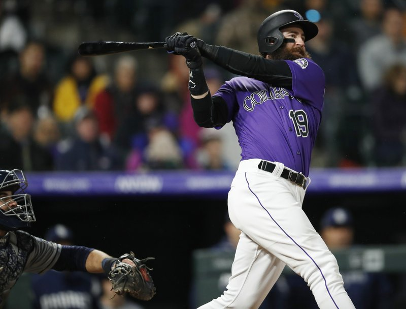 Colorado Rockies' Charlie Blackmon watches his solo home run off San Diego Padres relief pitcher Craig Stammen during the eighth inning of a baseball game Saturday, May 11, 2019, in Denver. (AP Photo/David Zalubowski)