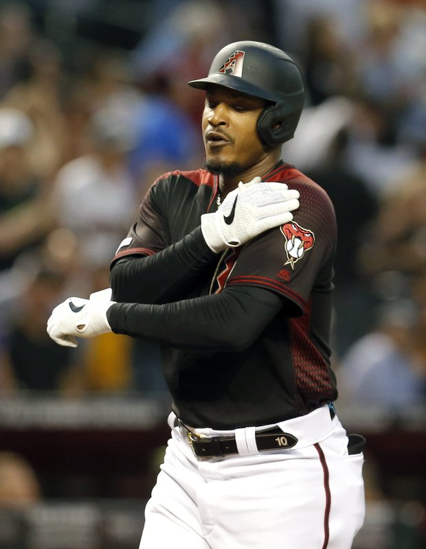 Arizona Diamondbacks' Adam Jones celebrates after hitting a solo home run against the Atlanta Braves in the seventh inning during a baseball game, Saturday, May 11, 2019, in Phoenix. (AP Photo/Rick Scuteri)