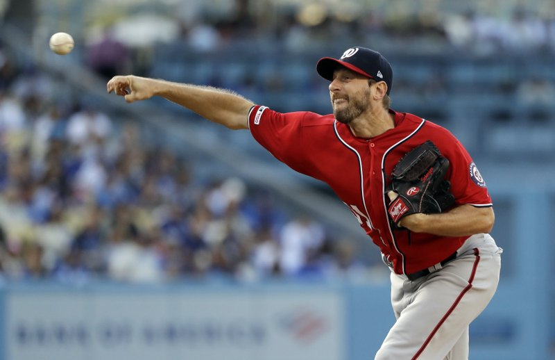 Washington Nationals starting pitcher Max Scherzer throws to a Los Angeles Dodgers batter during the first inning of a baseball game Saturday, May 11, 2019, in Los Angeles. (AP Photo/Marcio Jose Sanchez)