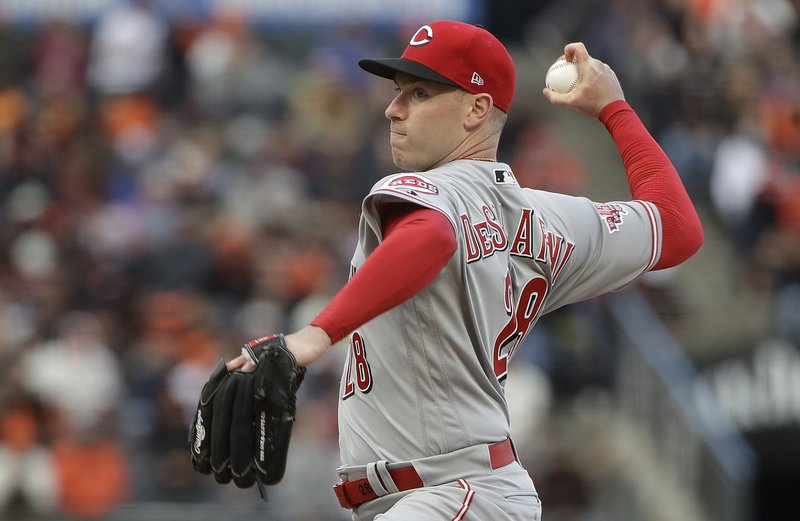 Cincinnati Reds pitcher Anthony DeSclafani throws to a San Francisco Giants batter during the first inning of a baseball game in San Francisco, Saturday, May 11, 2019. (AP Photo/Jeff Chiu)