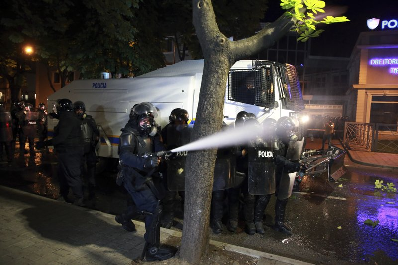Riot police spray tear gas against protesters during clashes in Tirana, Saturday, May 11, 2019. 2019. (AP Photo/Hektor Pustina)