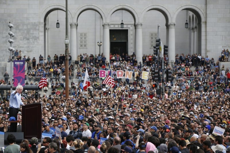 FILE - In a Saturday, March 23, 2019 file photo, Democratic presidential candidate Sen. Bernie Sanders speaks to people gathered at a rally at Grand Park in Los Angeles. (AP Photo/Damian Dovarganes, File)
