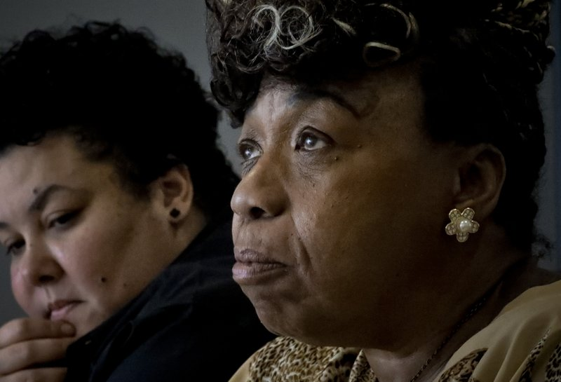 In this Wednesday May 8, 2019, photo, Loyda Colon, left, co-Director of the Justice Committee, listens while Gwen Carr, right, mother of Eric Garner, an unarmed black man who died as he was being subdued in a chokehold by NYPD police officer Daniel Pantaleo nearly five years ago, speaks during an interview, Wednesday May 8, 2019, in New York. (AP Photo/Bebeto Matthews)