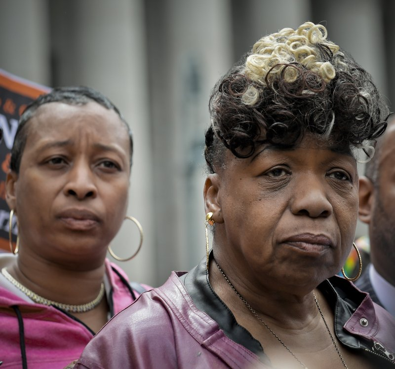 In this Thursday May 9, 2019 photo, Ellisha Garner, left, and Gwen Carr, right, her mother and mother of Eric Garner, an unarmed black man who died as he was being subdued in a chokehold by police officer Daniel Pantaleo nearly five years ago, hold a press conference after leaving court in New York. (AP Photo/Bebeto Matthews)