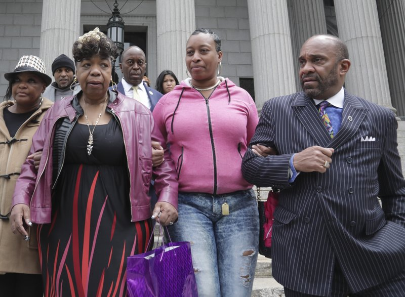 In this Thursday May 9, 2019 photo, Gwen Carr, second from left, mother of Eric Garner- an unarmed black man who died as he was being subdued in a chokehold by police officer Daniel Pantaleo nearly five years ago, and his sister Ellisha Garner, second from right, and his cousin Michael Garner, far right, leave court in New York. (AP Photo/Bebeto Matthews)