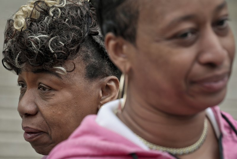 In this Thursday May 9, 2019 photo, Gwen Carr, left, mother of Eric Garner- an unarmed black man who died as he was being subdued in a chokehold by police officer Daniel Pantaleo nearly five years ago, and her daughter Ellisha Garner, right, leave court in New York. (AP Photo/Bebeto Matthews)