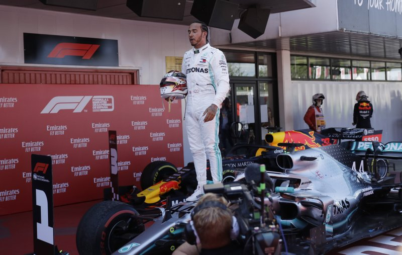 Mercedes driver Lewis Hamilton of Britain celebrates after winning the Spanish Formula One race at the Barcelona Catalunya racetrack in Montmelo, just outside Barcelona, Spain, Sunday, May 12, 2019. (AP Photo/Emilio Morenatti)