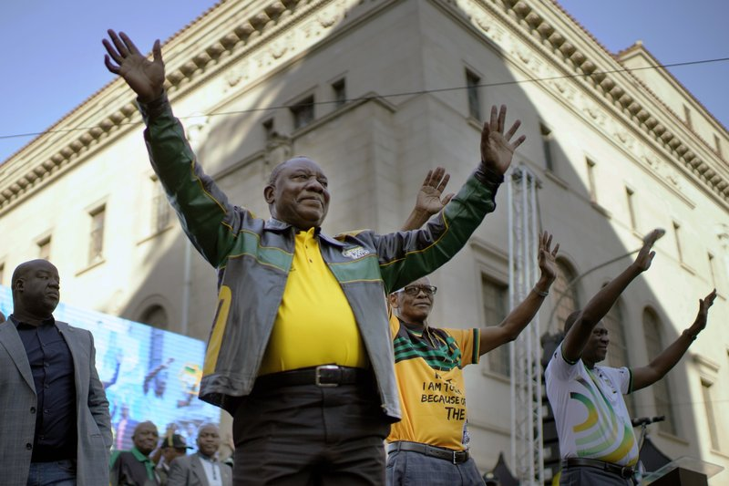 African National Congress party (ANC) President Cyril Ramaphosa arrives to address a rally at the ANC's headquarters in Johannesburg , South Africa, Sunday May 12, 2019. (AP Photo/Jerome Delay)