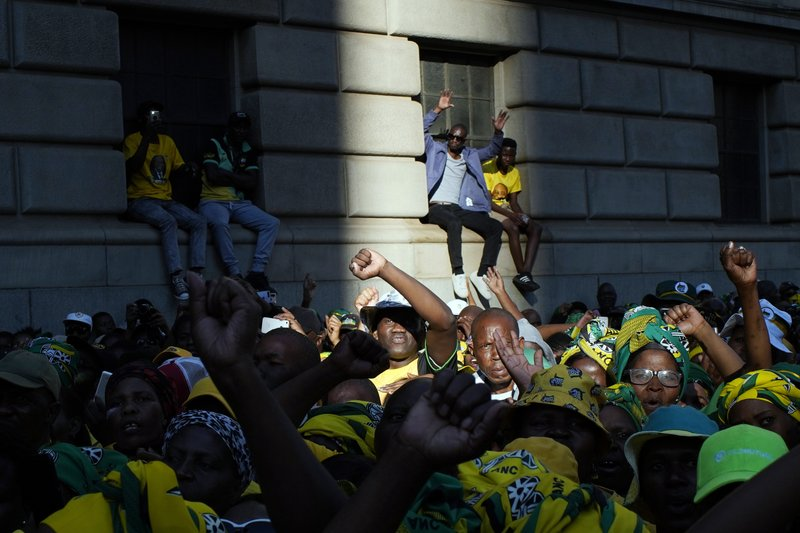 African National Congress party (ANC) supporters gather at the ANC's headquarters in Johannesburg, South Africa, Sunday May 12, 2019 to celebrate their party's victory in South Africa's general election and cheer President Cyril Ramaphosa during his speech. (AP Photo/Jerome Delay)