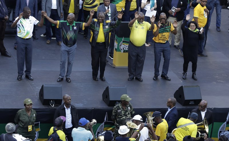 African National Congress (ANC), president Cyril Ramaphosa, center, with his national executive greets supporters during their celebration for election victory in Johannesburg, South Africa, Sunday, May 12, 2019. (AP Photo/Themba Hadebe)