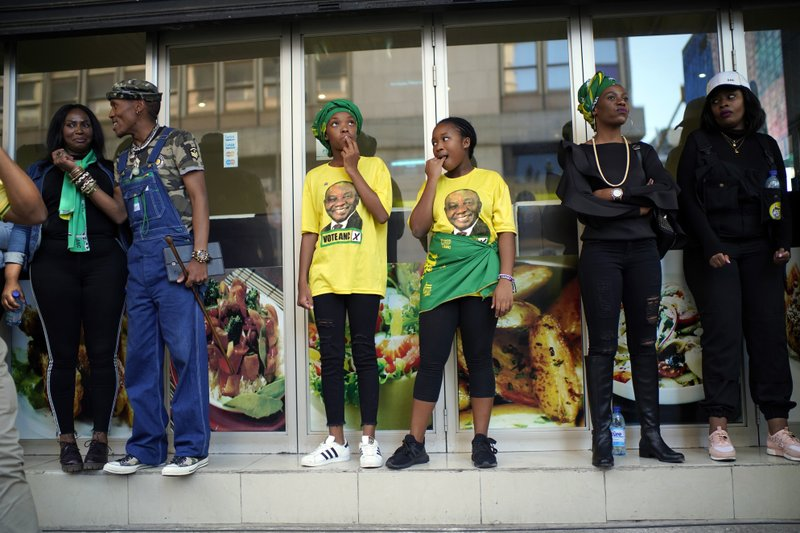 African National Congress party (ANC) supporters gather at the ANC's headquarters in Johannesburg , South Africa, Sunday May 12, 2019 to celebrate their party's victory in South Africa's general election. (AP Photo/Jerome Delay)