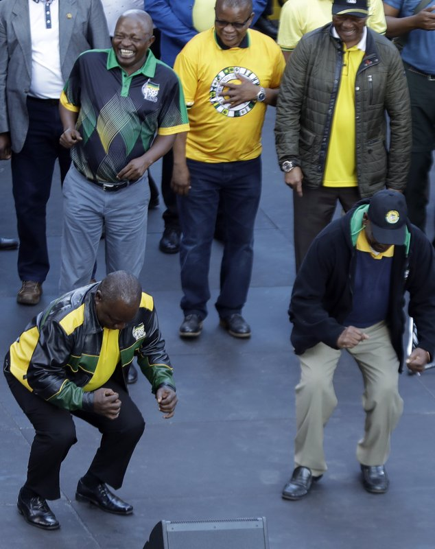 African National Congress (ANC), president Cyril Ramaphosa, left, dances with party member during their celebration for election victory in Johannesburg, South Africa, Sunday, May 12, 2019. (AP Photo/Themba Hadebe)