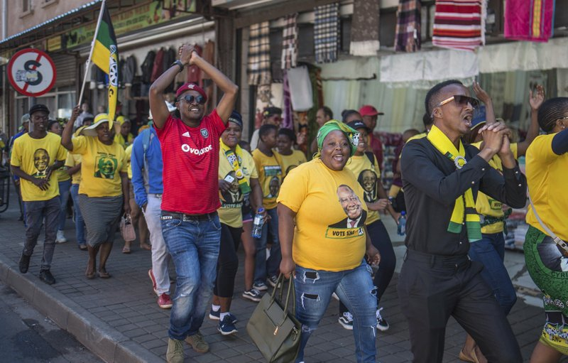 African National Congress (ANC) supporters gather outside the party's headquarters in downtown Johannesburg, Sunday, May 12, 2019 to celebrate the party's win in elections. (AP Photo/Mujahid Safodien)