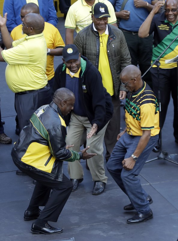 African National Congress (ANC), president Cyril Ramaphosa, left, dances with secretary-general Ace Magashule during their celebration of the election victory in Johannesburg, South Africa, Sunday, May 12, 2019. (AP Photo/Themba Hadebe)