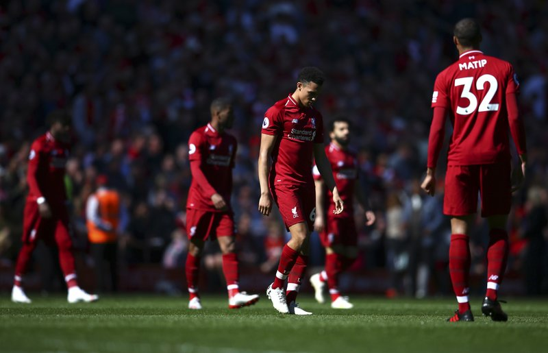 Liverpool players come out for the second half during the English Premier League soccer match between Liverpool and Wolverhampton Wanderers at the Anfield stadium in Liverpool, England, Sunday, May 12, 2019. (AP Photo/Dave Thompson)