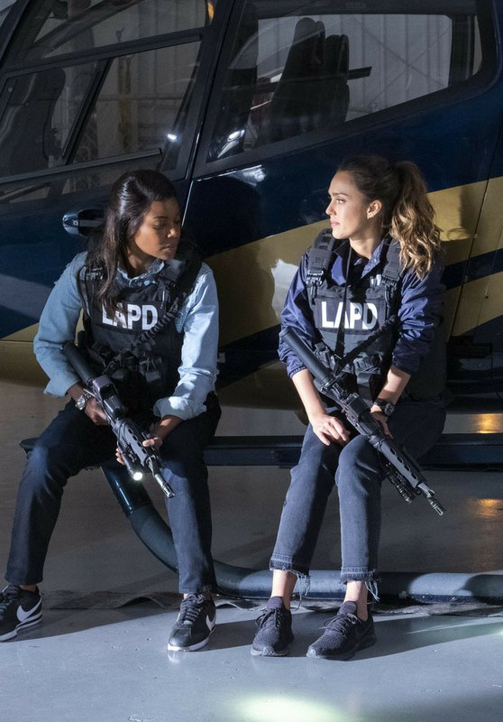 This image released by Spectrum Originals dhows Gabrielle Union, left, and Jessica Alba in a scene from
