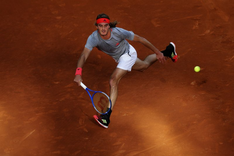 Greece's Stefanos Tsitsipas plays a shot against Serbia's Novak Djokovic during the final of the Madrid Open tennis tournament in Madrid, Spain, Sunday, May 12, 2019. (AP Photo/Bernat Armangue)