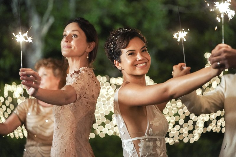 This image released by NBC shows Sarah Wayne Callies, left, and Michele Weaver in a scene from