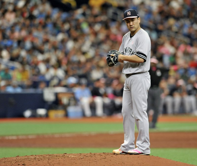 New York Yankees starter Mashiro Tanaka looks toward first base after giving up a single to Tampa Bay Rays' Ji-Man Choi during the sixth inning of a baseball game Sunday, May 12, 2019, in St. (AP Photo/Steve Nesius)