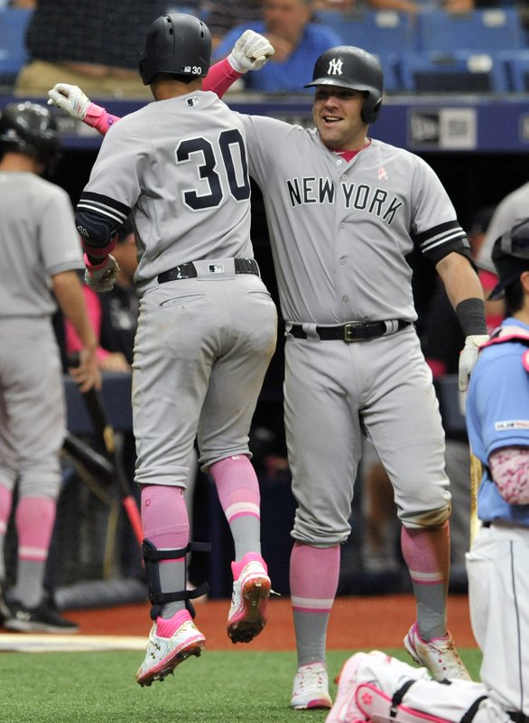New York Yankees' Thairo Estrada (30) celebrates with Austine Romine, right, after hitting a solo home run off Tampa Bay Rays reliever Austin Pruitt during the ninth inning of a baseball game Sunday, May 12, 2019, in St. (AP Photo/Steve Nesius)