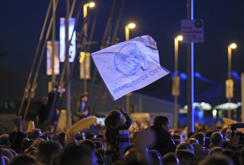Manchester City supporters gather as they await the arrival of the team to celebrate at the Etihad Stadium in Manchester, England, Sunday May 12, 2019 the day they won the English Premier League title. (AP Photo/Jon Super)