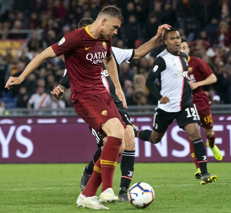 Romas Edin Dzeko scores the 2-0 goal during Serie A soccer match as Roma - FC Juventus at Olimpico Stadium in Rome, Sunday, May 12, 2019. (Claudio Peri/ANSA via AP)