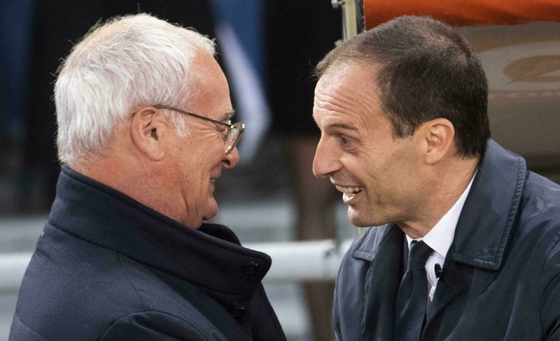 Roma's Head Coach Claudio Ranieri, left, greets Juventus coach Massimiliano Allegri during Italian Serie A soccer match between Roma and FC Juventus at the Olimpico Stadium in Rome, Sunday, May 12, 2019. (Claudio Peri/ANSA via AP)