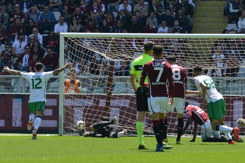 Sassuolo's Medhi Bourabia, right, scores his first side's goal during the Italian Serie A soccer match between Torino and Sassuolo in Turin, Italy, Sunday, May 12, 2019. (Andrea Di Marco/ANSA Via AP)