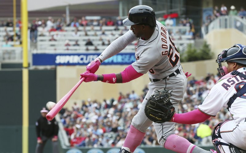 Detroit Tigers' Niko Goodrum hits a sacrifice fly off Minnesota Twins relief pitcher Trevor Hildenberger in the seventh inning of a baseball game Sunday, May 12, 2019, in Minneapolis. (AP Photo/Jim Mone)