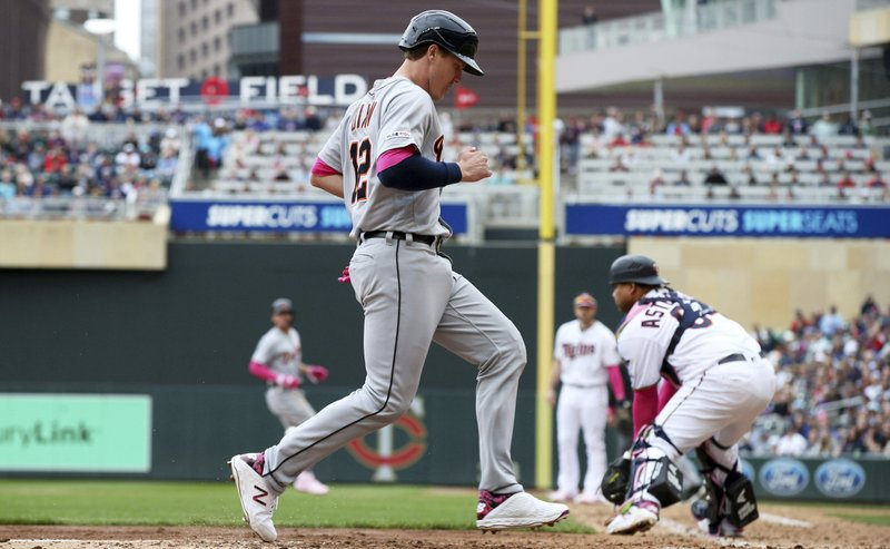 Detroit Tigers' Brandon Dixon scores on a sacrifice fly by Niko Goodrum off Minnesota Twins relief pitcher Trevor Hildenberger in the seventh inning of a baseball game Sunday, May 12, 2019, in Minneapolis. (AP Photo/Jim Mone)