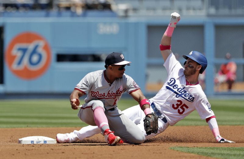 Los Angeles Dodgers' Cody Bellinger (35) steals second base past Washington Nationals shortstop Wilmer Difo during the second inning of a baseball game Sunday, May 12, 2019, in Los Angeles. (AP Photo/Marcio Jose Sanchez)