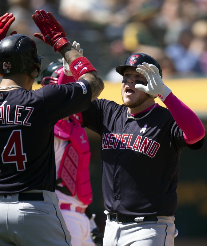 Cleveland Indians' Roberto Perez, right, celebrates his three-run home run against the Oakland Athletics during the sixth inning of a baseball game, Sunday, May 12, 2019, in Oakland, Calif. (AP Photo/D. Ross Cameron)