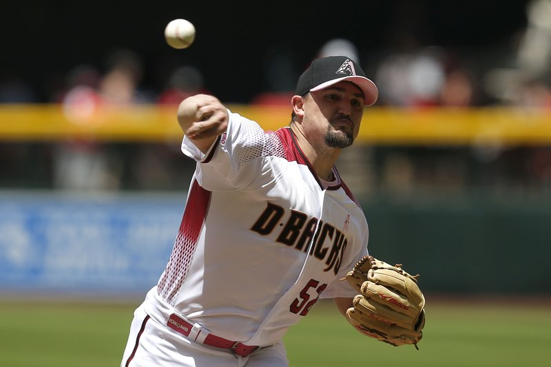 Arizona Diamondbacks pitcher Zack Godley throws against the Atlanta Braves in the first inning during a baseball game, Sunday, May 12, 2019, in Phoenix. (AP Photo/Rick Scuteri)
