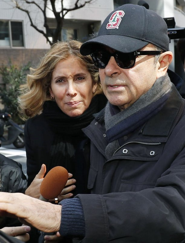FILE - This March, 2019, file photo shows former Nissan Chairman Carlos Ghosn, right, and his wife Carole in Tokyo. (Kyodo News via AP)